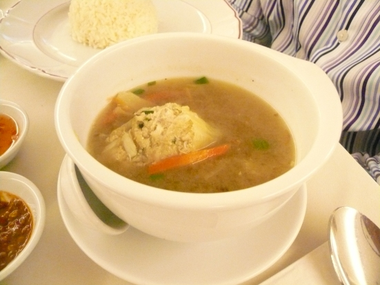 A simple soup of meatballs and shredded bamboo shoots in a clear chicken broth. The meatballs are made from minced pork and prawn, shredded crab meat and julienned turnips.