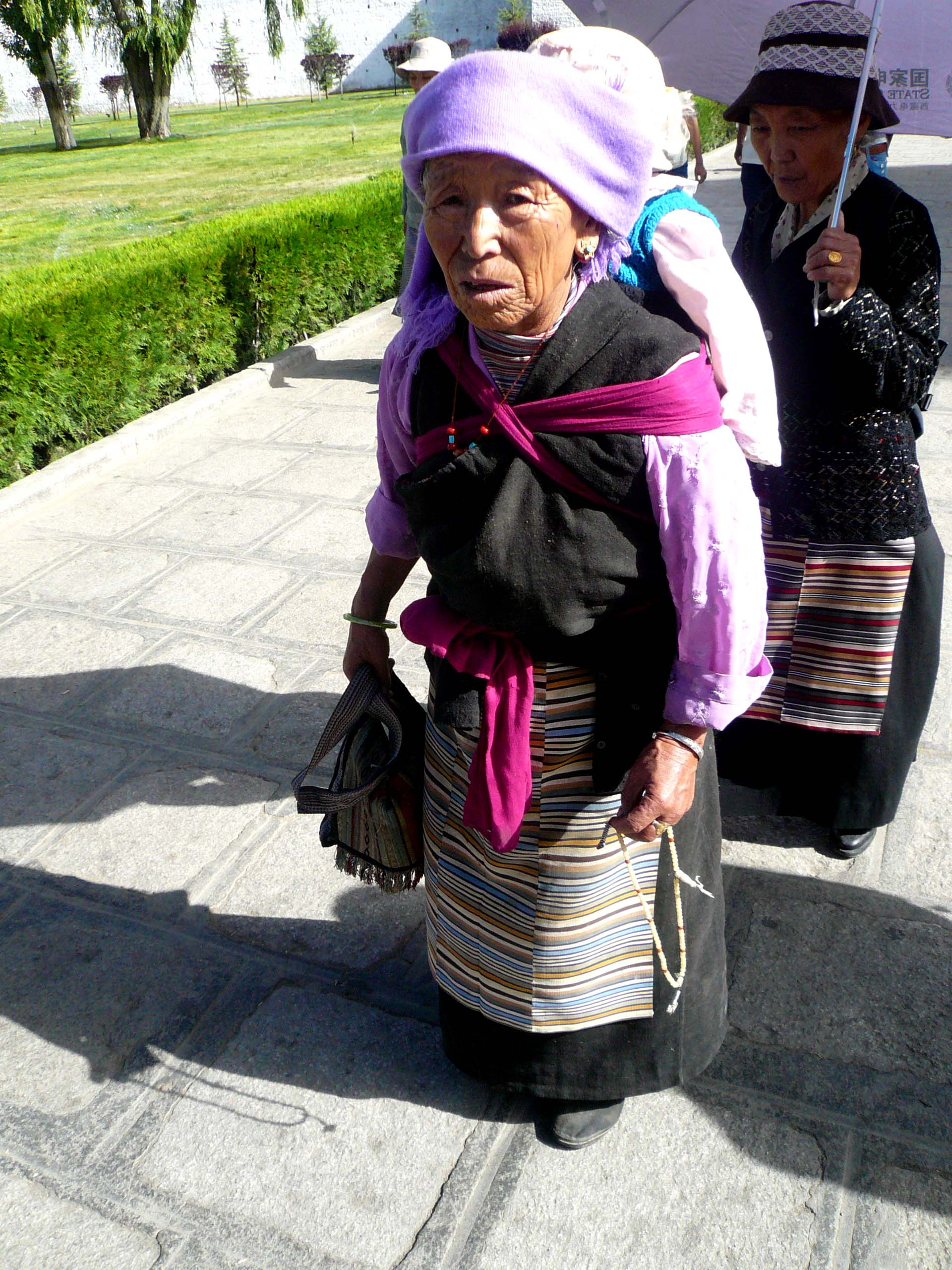 A local old lady doing her daily prayer rounds at the Palace parameters